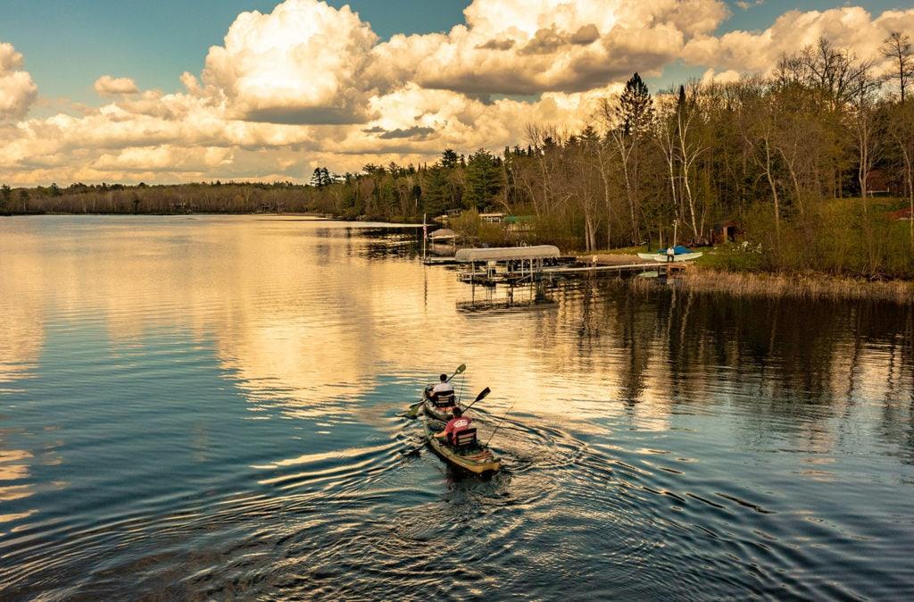 Two people kayak on the lake