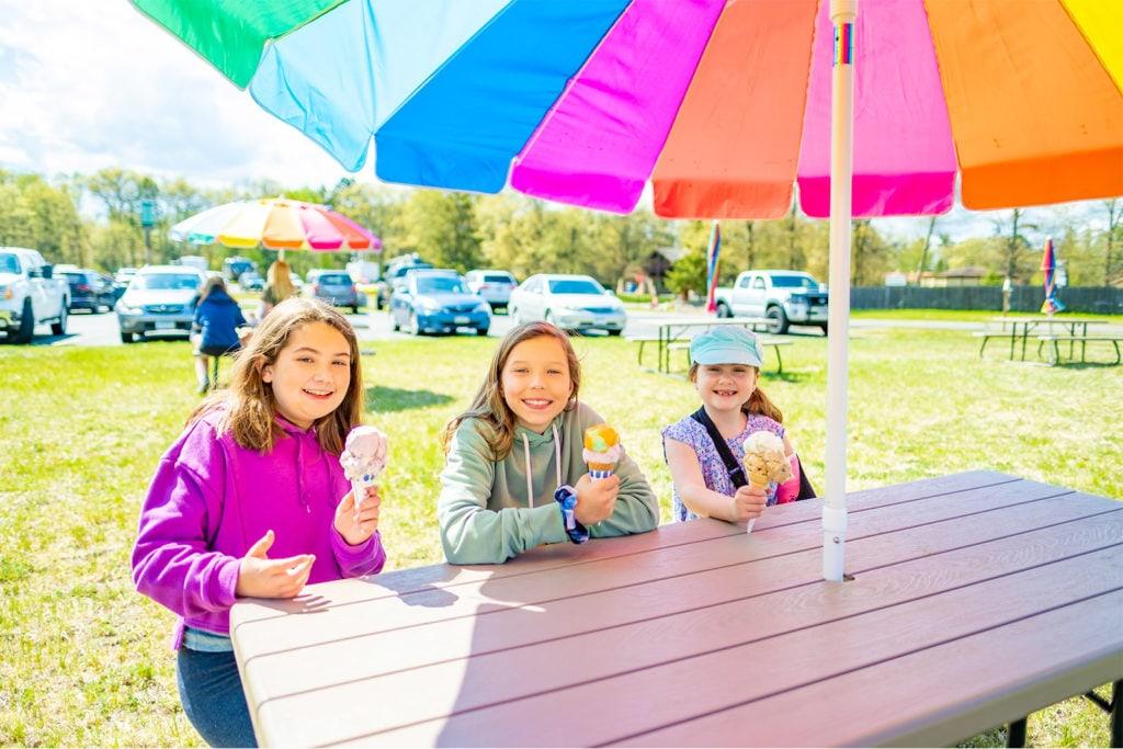 Three children eating ice cream cones