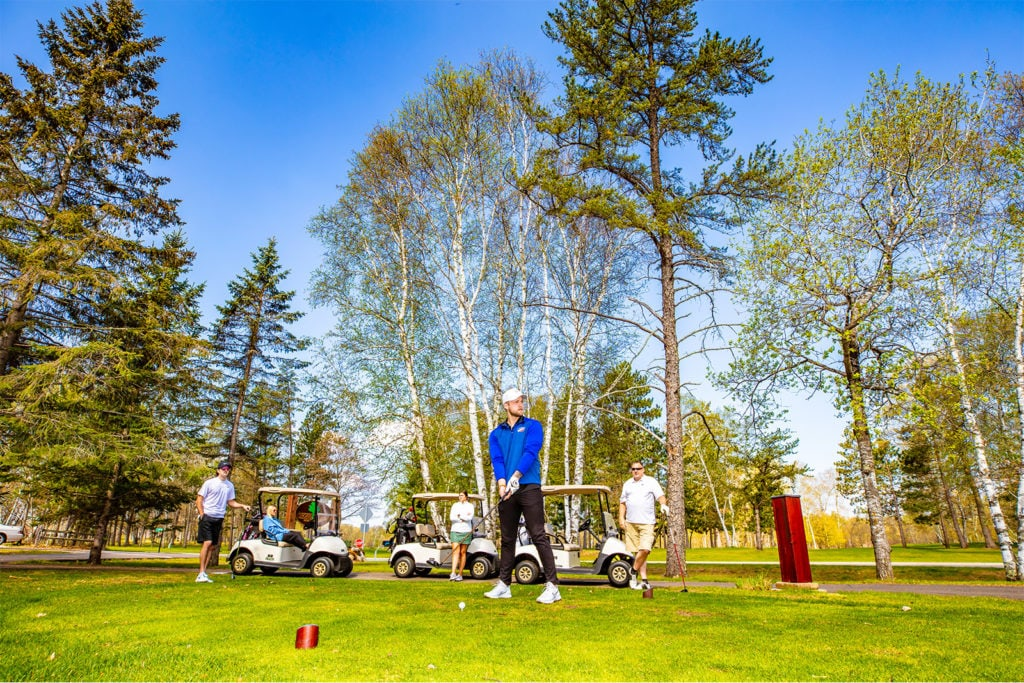 Golfers at the Whitefish Chain