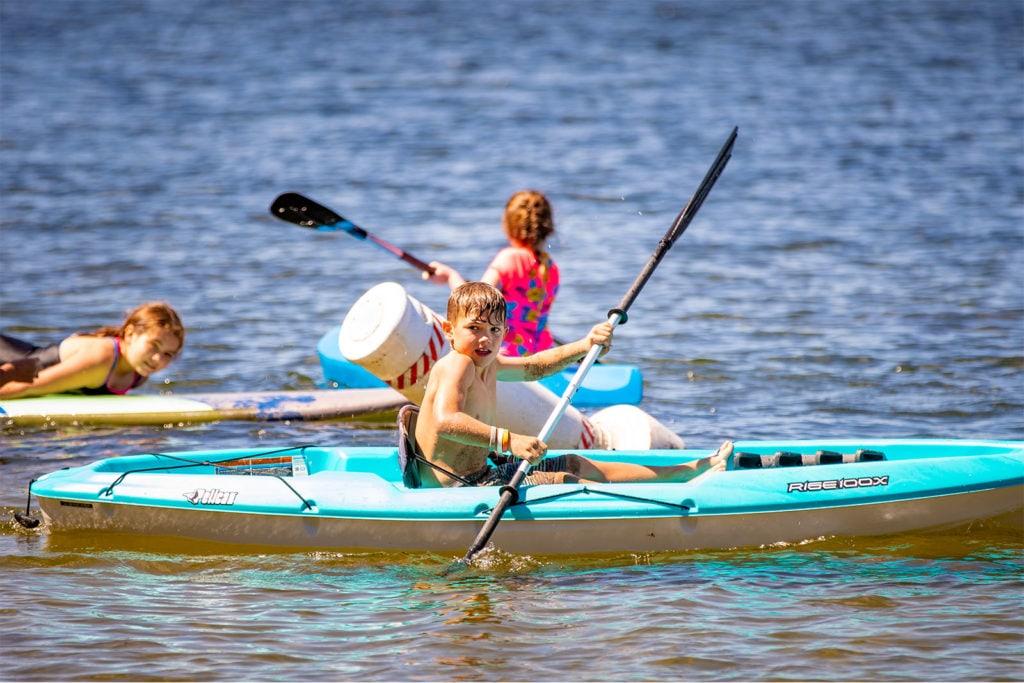 A child kayaking