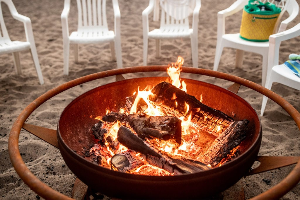 Fire pit on the beach at Boyd Lodge