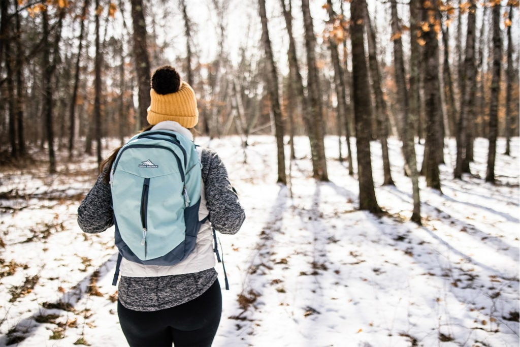 A woman hiking during winter